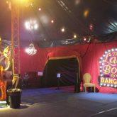 The audience entered each venue through an entrance pavilion manufactured from nine wine Cabaret Sparkle Velvet Velour (VEL070) drapes.