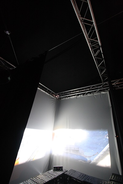 J&C Joel provided support by supplying black Wool Serge to form the walls and ceiling for the space. The firm also provided two projection screens which were used as part of the installation.